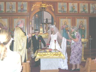 A picture of Mike, me, and our sponsors and priest performing the Dance of Isaiah at our wedding.
